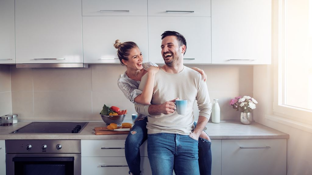 Couple hugging in their new kitchen