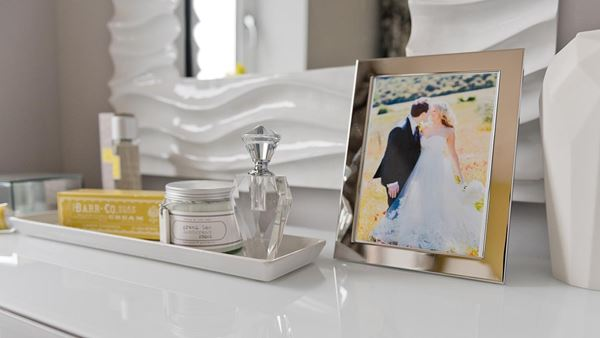 Dressing table with framed wedding picture. Example of a typical Latimer property.